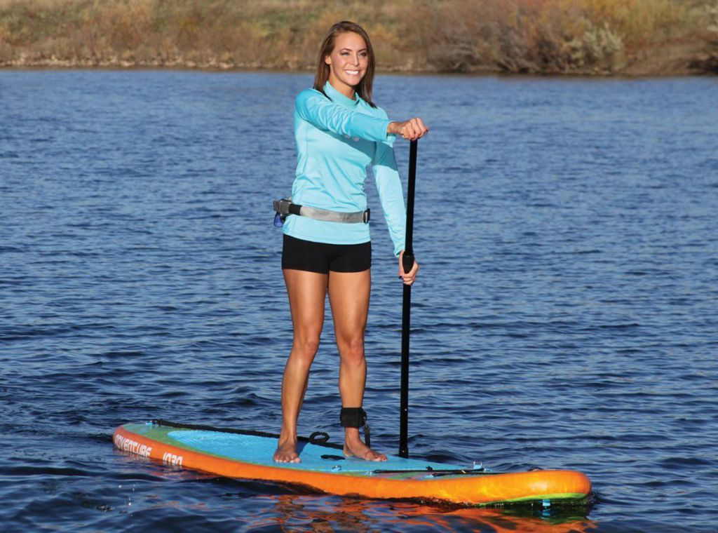 woman riding sportsstuff 1030 adventure inflatable stand up paddle board