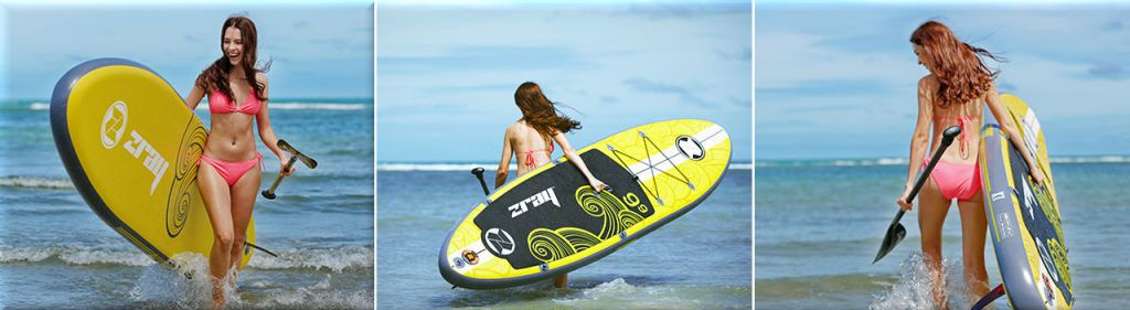 woman carrying z-ray x1 inflatable stand up paddle board